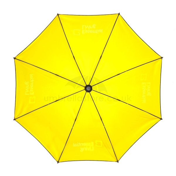 Printed Double canopy umbrella viewed from inside, with yellow inner canopy.