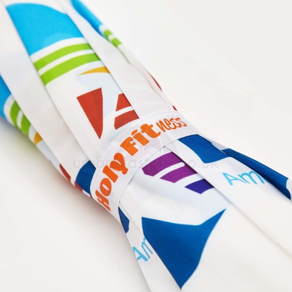 Printed Pro brella vented umbrella viewed from body, with Rainbow vented panels and dye sublimation print on lower panels.
